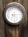 Thermometer with humidity meter on boards Stock Photo