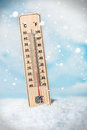 Thermometer on snow shows low temperatures the sky background with clouds Stock Photography