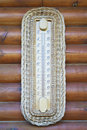 Thermometer on wooden wall Royalty Free Stock Images