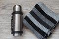 Thermos flask made of stainless steel on a woden background. Top view Royalty Free Stock Photo