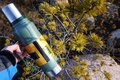 stock image of  Thermos for hot and cold drinks with handle. With this thermos you can go Hiking