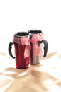 Thermos two mug tied with red ribbon Stock Photos