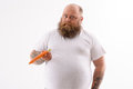 Thick bearded guy with healthy vegetable Royalty Free Stock Photo
