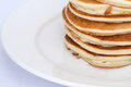 Thick pancakes are stacked on a plate Royalty Free Stock Photo
