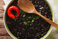 Thick soup of black bean with chilli peppers close up in a bowl. Royalty Free Stock Photo