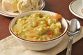 Thick split pea soup a bowl of with chunks of ham Stock Images