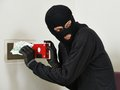 Thief burglar at house safe breaking stealing euro money during home codebreaking Royalty Free Stock Photography