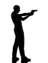 Thief criminal terrorist aiming gun man silhouette in studio isolated on white background Stock Photography
