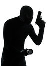 Thief criminal terrorist in silhouette studio isolated on white background Stock Images