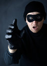 Thief grab a reaching out to seal in a dark setting Royalty Free Stock Photography