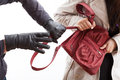 Thief holding a bag closeup of wearing gloves woman s Royalty Free Stock Images