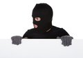Thief looking around a blank sign Royalty Free Stock Photo