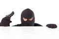 Thief with a pistol capped and the white bottom Royalty Free Stock Photo
