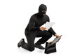 A thief reading a confidential documents Royalty Free Stock Images