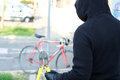 Thief stealing a bike in the city street Royalty Free Stock Photo