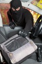 Thief stealing a car handbag from woman in Stock Photo