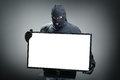 Thief stealing computer monitor or television concept for hacker security or insurance with space on screen for message Stock Image