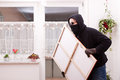 Thief steals a painting masked Stock Photo