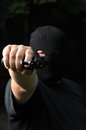 Thief threatening with a gun masked Stock Photos