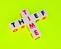 Thief of time text and inscribed in uppercase letters on small white cubes and arranged crossword style with common letter i Royalty Free Stock Photography