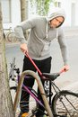 Thief trying to break the bicycle lock Royalty Free Stock Photo
