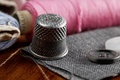 Thimble and sewing items closeup photo Royalty Free Stock Photography