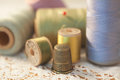 Thimble and spools closeup of vintage of thread Stock Photo
