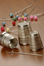 Thimbles and needles Royalty Free Stock Photography