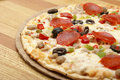 Thin Crust Deluxe Pizza Stock Image
