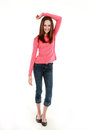 Thin pretty preteen girl smiling full length of brunette tween Royalty Free Stock Image