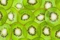 Thin sliced kiwi fruit peel top view like backround beautiful ornament juicy background from segments of kiwi shallow dof Stock Photo