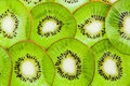 Thin sliced ​​kiwi fruit peel top view like backround beautiful ornament juicy background from segments of kiwi shallow dof Stock Photography
