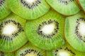 Thin sliced kiwi fruit peel top view like backround beautiful ornament juicy background from segments of kiwi top view macro Stock Photos