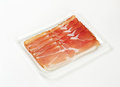 Thin slices of schwarzwald ham dry cured smoked on white background Royalty Free Stock Photos