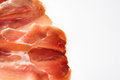 Thin slices of spanish serrano ham isolated on white background Royalty Free Stock Photo