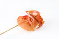 Thin slices spanish serrano ham skewer  on white background Royalty Free Stock Photo