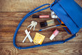 Things from open lady handbag. Royalty Free Stock Photo