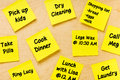 Things to do post it memo tasks female overhead shot of wooden board full of square yellow notes randomly glued reminding or or Royalty Free Stock Image