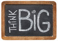Think big on blackboard motivational phrase white chalk handwriting a vintage slate Royalty Free Stock Photography
