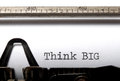 Think big the typed words printed with an old typewriter Stock Images