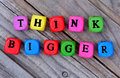 Think bigger words on table Royalty Free Stock Photo