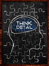 Think detail puzzle on blackboard Stock Photography