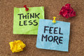 Think less feel more advice words of wisdom handwriting on colorful sticky notes Royalty Free Stock Photo