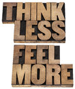 Think less feel more concept words of wisdom isolated text in vintage letterpress wood type Royalty Free Stock Image