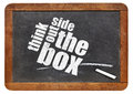 Think outside the box concept on a vintage slate blackboard Royalty Free Stock Images