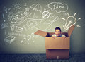 Think outside box. Young woman coming out of box Royalty Free Stock Photo