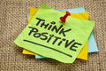 Think positive motivational reminder handwriting on sticky note Royalty Free Stock Photography