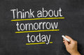 Think about tomorrow today blackboard with the text Royalty Free Stock Photo