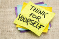 Think for yourself advice on a sticky note against burlap canvas Stock Images