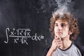 Thinking boy solving equation with smoking head Royalty Free Stock Photo